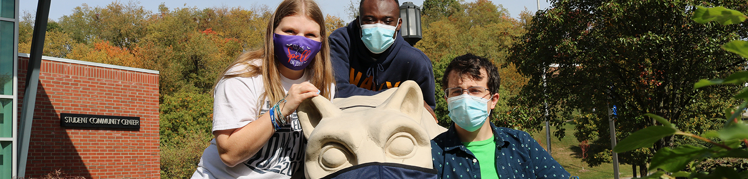 Students around the masked lion shrine.