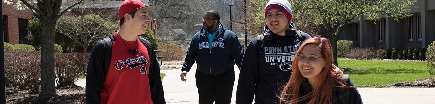 Students walking along path way on campus