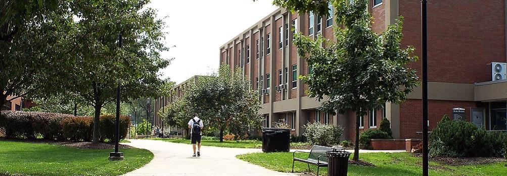 boy walking on campus
