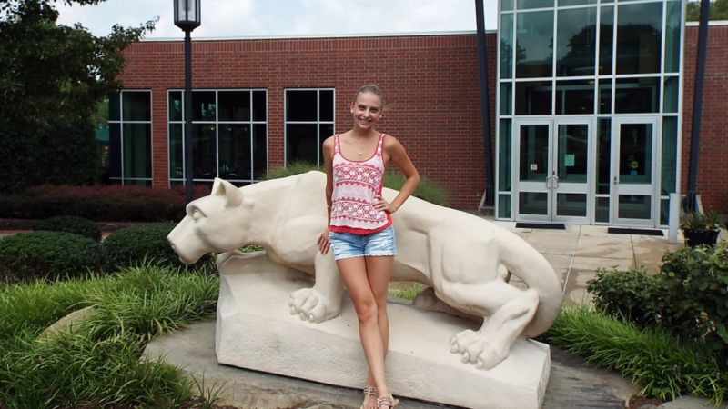 girl in front of lion statue