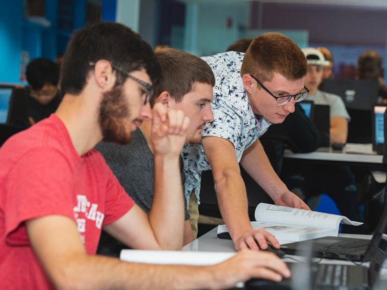 Students looking at computer screens