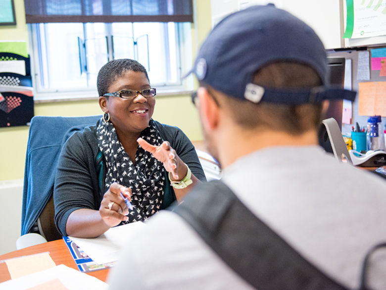 A Penn State Greater Allegheny staff member councils a student.