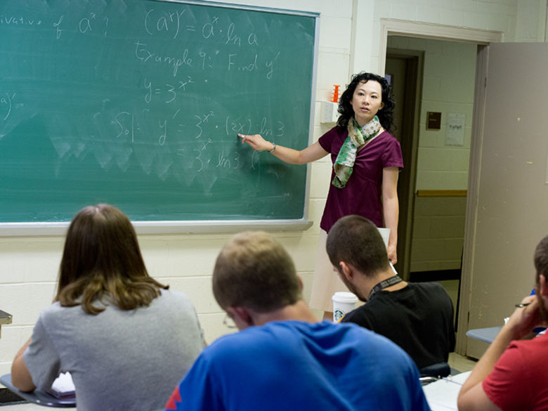 A Penn State Greater Allegheny faculty member in front of a class teaching.
