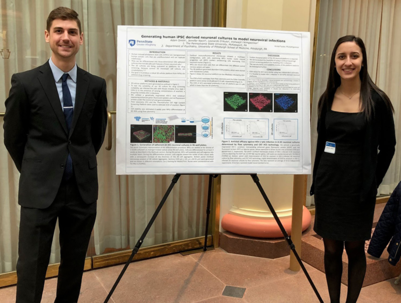 Students Adam Smith (Greater Allegheny) and Jennifer Naciri (University of Pittsburgh) standing next to their research at the Undergraduate Research at The Capitol Pennsylvania (URC-PA) event.