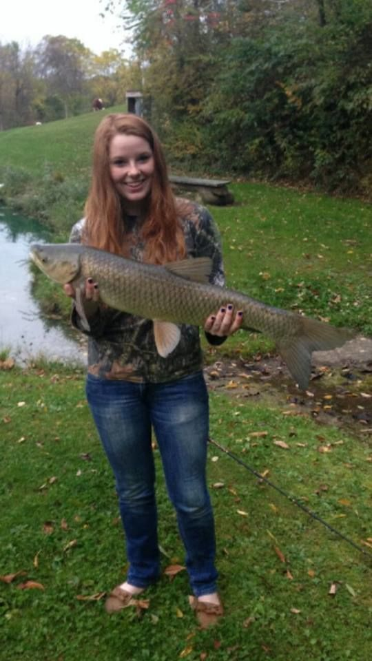 student holding large fish