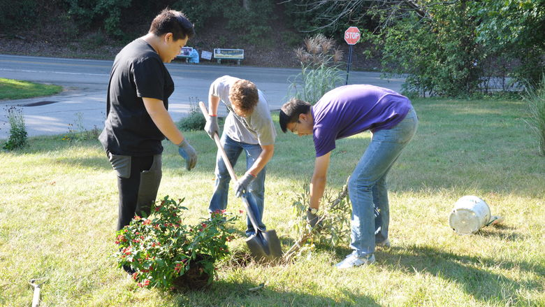 Students digging in campus garden