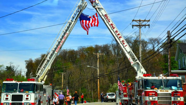 firetrucks with flag