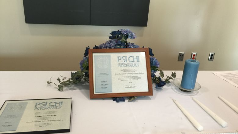 Psi Chi charter plaque at induction ceremony