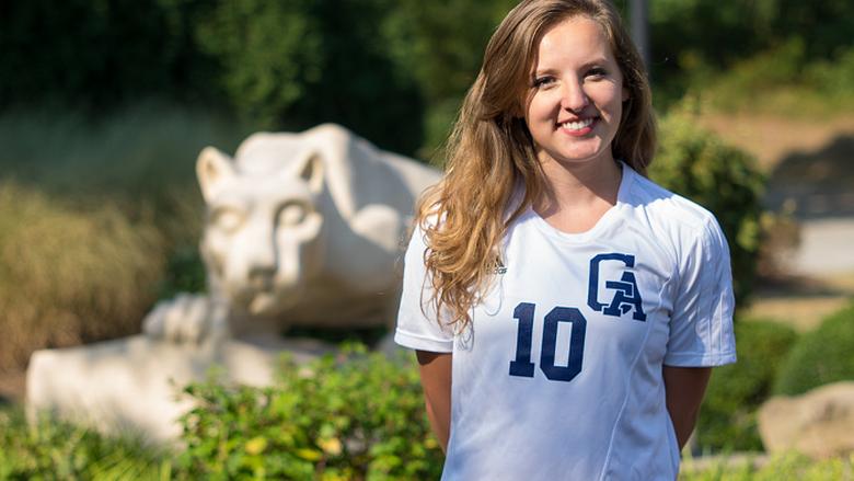 woman smiling near lion statue