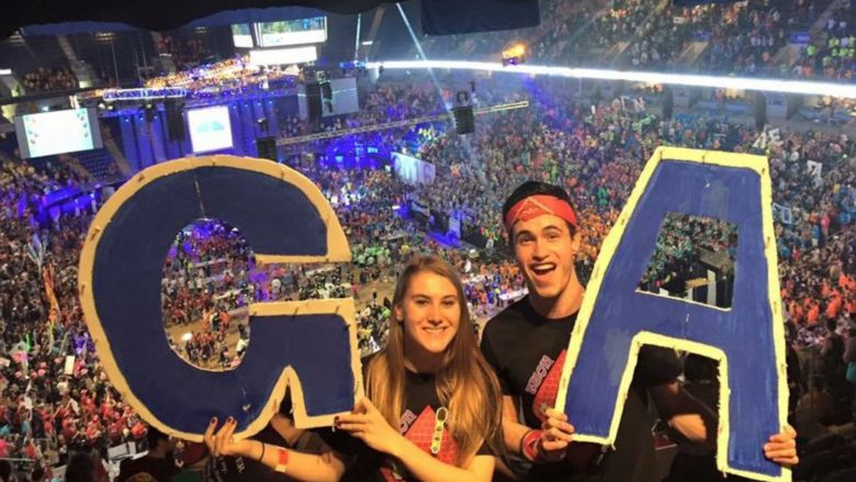 students holding GA letters