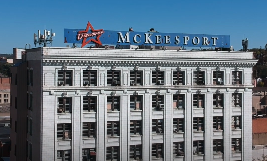 Building with a sign on the roof that reads Mckessport.